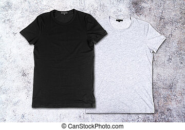 blank t-shirts on the background of concrete wall