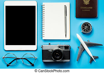 Blank tablet screen with hipster blogger travel objects