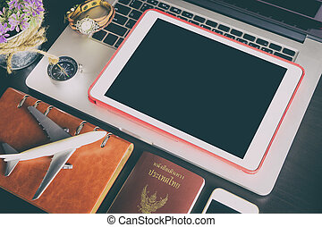 Blank Tablet screen with travel objects for business traveler