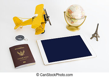 Blank tablet screen with world travel objects on white background
