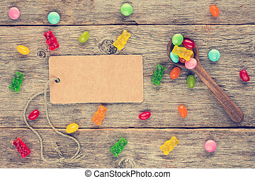 Blank tag and spoon with candies