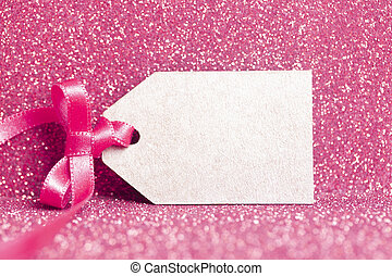 Blank tag tied with pink ribbon. Price tag, gift tag, sale tag, address label.