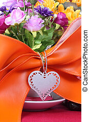 Blank tag with colorful artificial flower