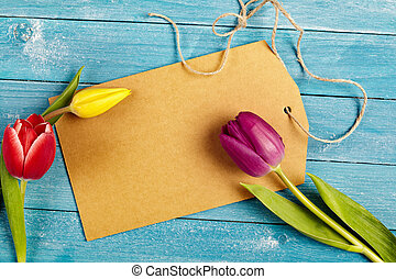 Blank tag with fresh spring tulips