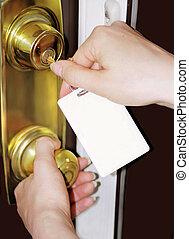blank tag - woman unlocks door with bland key tag
