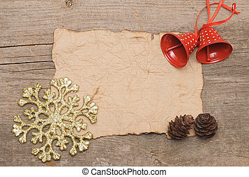 Blank vintage paper with Christmas decorations on wood