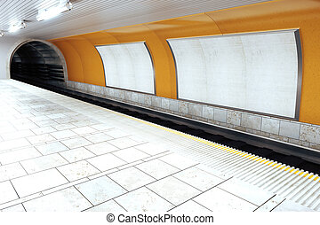 Blank white billboards in empty subway station, mock up