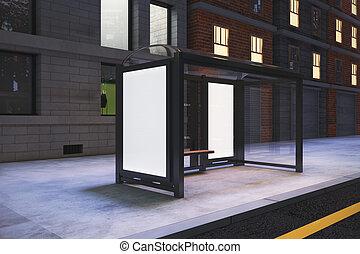 Blank white billboards on bus station on night city street, mock up