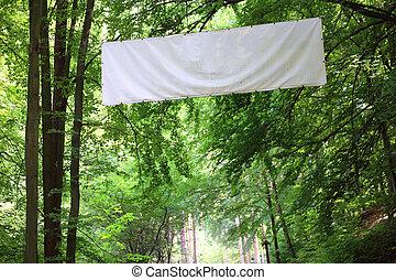 Blank white board banner green trees