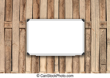 Blank white board on bamboo fence with sepia filter