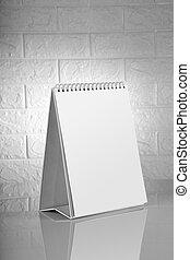 Blank White Calendar for Mockups on Brick Wall Background
