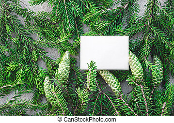 Blank white card and green fir branches