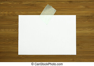 blank white card on wooden background