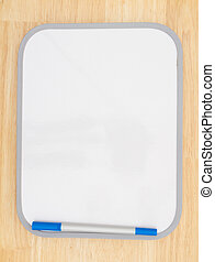 Blank white dry erase board with marker on wood textured ...