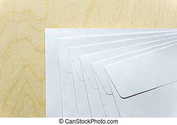 Blank white envelopes on wooden desk