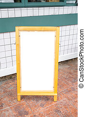 Blank white menu stand on floor in front of restaurant