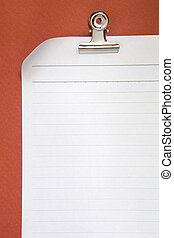 blank white paper on red background with clip