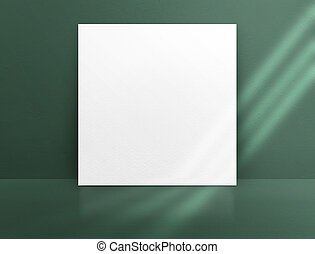 Blank white paper poster leaning at green color concrete...