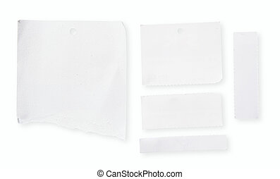 a few pieces of blank white paper paper with tattered edge with clipping path on white background