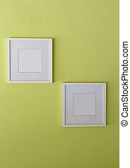 Blank white picture frame on limegreen wall