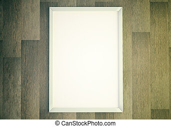 Blank white picture frame on wooden wall, mock up