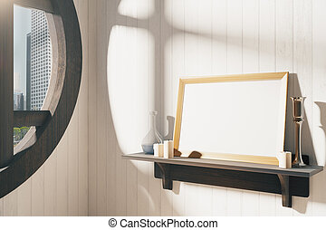 Blank white picture frame with candlestick on brown wooden shelf at sunrise, mock up