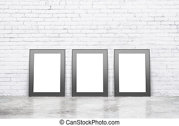 Blank white pictures with black frame on concrete floor with white brick wall, mock up