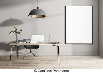 Blank white poster in black frame on light wall in sunny home office with wooden floor and table with laptop and black lamp from top. 3D rendering, mockup