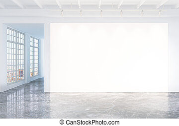 Blank white poster on white wall in empty loft room with concrete floor and big windows, mock up