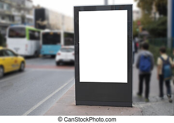 Blank white rectangular billboard at the roadside. On the left comes 2 teenagers on foot.