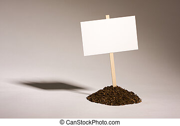 Blank White Sign in Dirt Pile