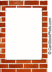 Blank white sign on a colorful brick wall.