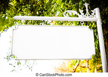Blank white vintage metal hanging signboard with copy space