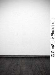 blank white wall and wooden floor