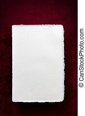 Blank White Writing Paper over Rich Red Background