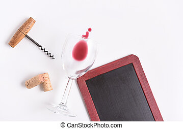 Chalkboard with wine glass, corkscrew, corks, and wine spill