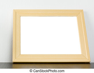 Blank Wooden frame on shelf with copy space