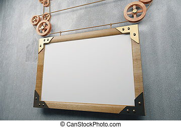 Blank wooden picture frame in steampunk style on concrete wall, mock up
