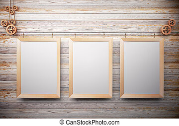 Blank wooden picture frames on wooden wall, mock up