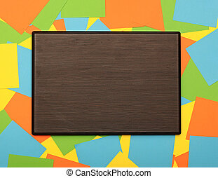 blank wooden plate with copy space on colorful background