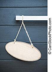 Blank wooden sign hanging on the door