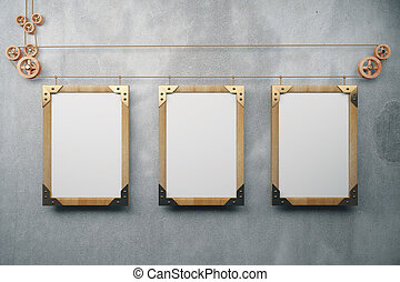 Blank wooden steampunk picture frames on grey concrete wall, mock up