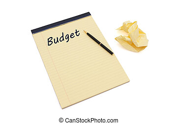 Writing your Budget - Blank yellow lined notepad with...