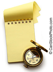 Blank yellow notepad with compass