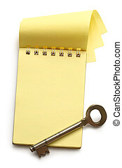 Blank yellow notepad with key