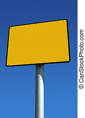 Blank yellow sign ready for text and blue sky.
