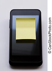 Blank yellow sticky note.