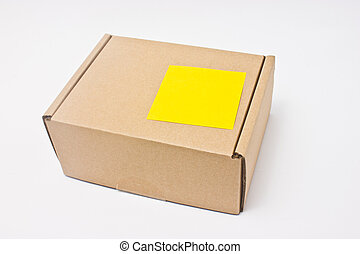 Blank yellow sticky note post on paper box.