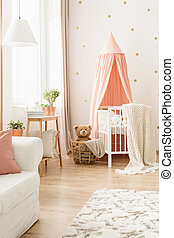Blanket on crib with canopy