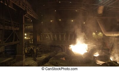 Blast furnace at the metallurgical plant. - Release of cast...